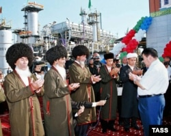 Muslim clergy Turkmen President Saparmurat Niyazov (right) pray at the opening of a gas compressor station at the Korpeje oil and gas field in 2006.