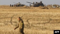 Ukrainian servicemen man positions with APCs and tanks near the town of Debaltseve, in the Donetsk region, on September 21.
