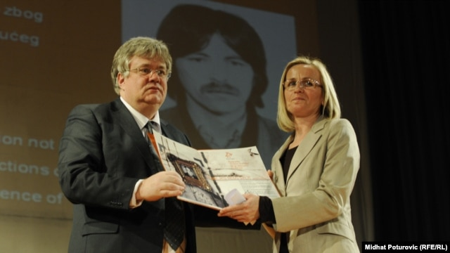 Stefica Galic (right) receives an award for bravery on behalf of her late husband, Nedeljko Galic, in Sarajevo in April.