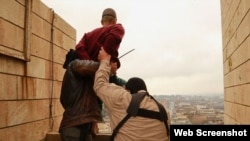 Islamic State militants prepare to throw man from high rooftop as punishment for being gay in Mosul. (file photo)