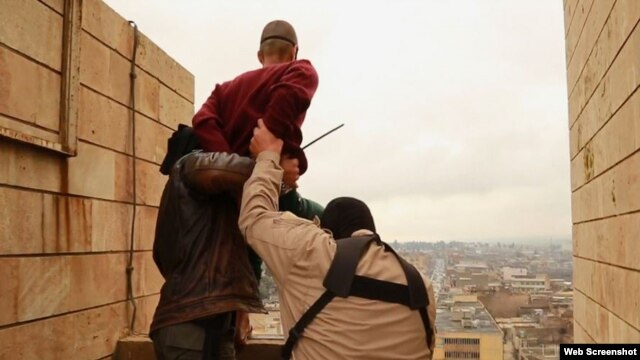 Islamic State militants prepare to throw a man from a high rooftop in Mosul as punishment for being gay.