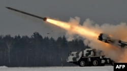 A Soviet-made Smerch (Tornado) heavy multiple rocket launcher fires during exercises in Belarus in 2011.
