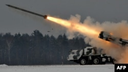 Belarus -- An army Smerch (Tornado), Soviet-made heavy multiple rocket launcher, fires during exercises in the Brest region, 25Jan2011