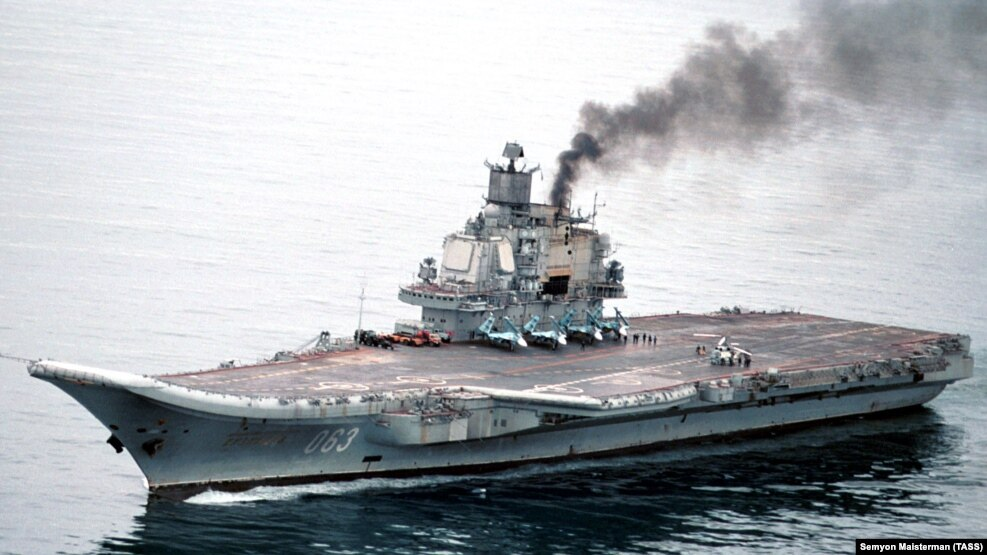 The eight-vessel Russian flotilla is being led by the aircraft carrier Admiral Kuznetsov (pictured, file photo).