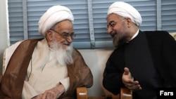 Iranian President Hassan Rouhani (R) meeting Grand Ayatollah Safi Golpaygani, July 2013