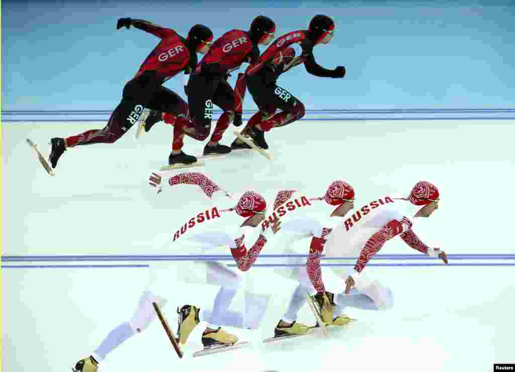 Germany's Samuel Schwarz (top) and Aleksei Yesin of Russia compete in race 1 of the men's 500-meters speed-skating event.