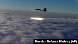 RUSSIA -- An Su-30 fighter jet of the Russian air force launches a missile during maneuvers in southern Russia, September 27, 2018