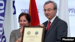 Armenia -- U.S. Ambassador Marie Yovanovitch gives an award to Hovik Musayelian, CEO of Synopsis-Armenia, 10Nov2010.