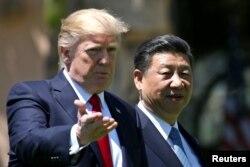 Дональд Трамп и Си Цзиньпин на переговорах во Флориде. 7 апреля 2017 года