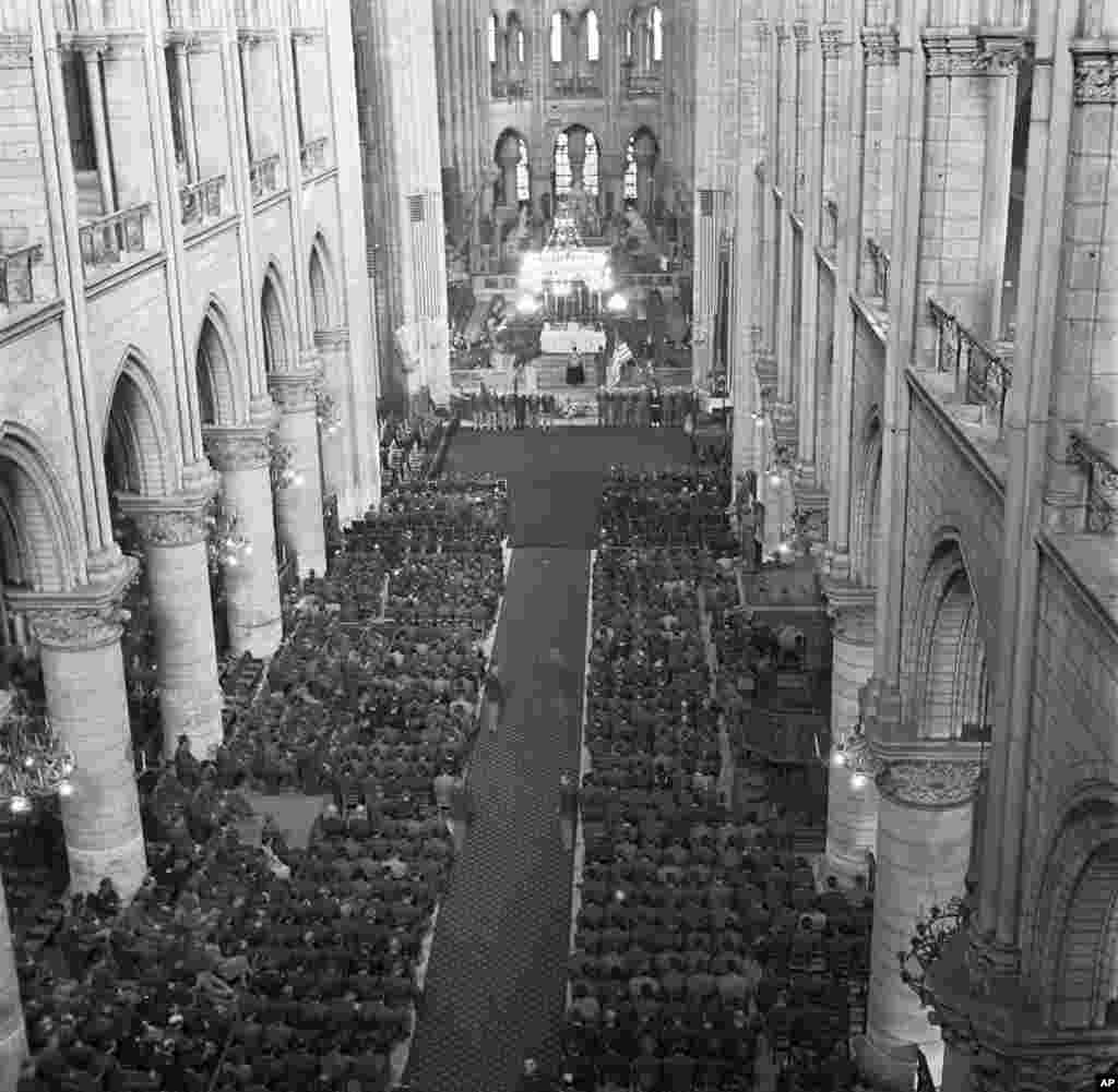 U.S. soldiers fill the pews of Notre Dame Cathedral on April 16, 1945, during the GI memorial service for U.S. President Roosevelt. This was less than a year after the liberation of the city during World War II.