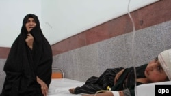 A girl who was injured by a roadside bomb gets medical treatment at a hospital in Herat in early July.