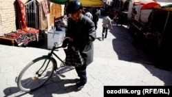 Uzbekistan - a man is returning from bazaar on bicycle, 07 April 2012