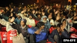 Indian fishermen, who were released by the Pakistani authorities, wave after crossing over to the Indian side of the India-Pakistan border, near Amritsar on December 29.