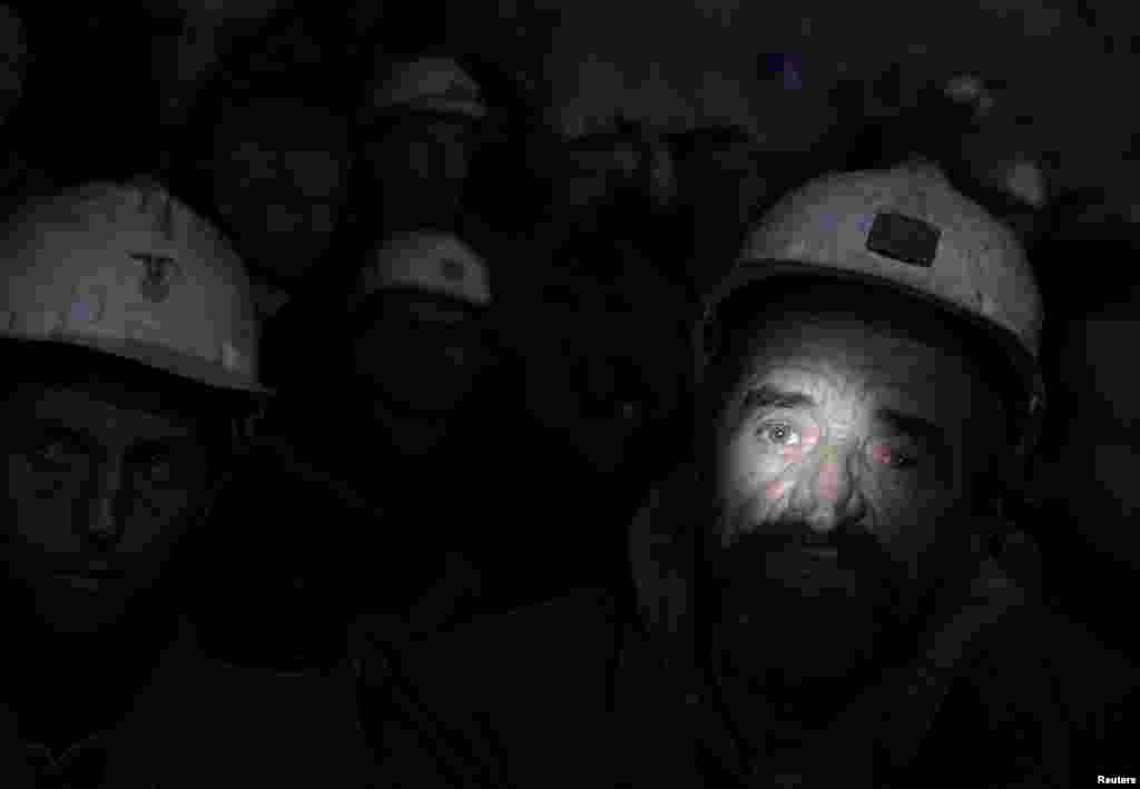 Hundreds of miners in Kosovo refused to resurface at the end of their shift to protest a government climbdown on the fate of the mine, which is claimed by the country's former master, Serbia. Fearing bankruptcy, Kosovo's new government said last week it would take control of the sprawling Trepca mining complex, but backtracked this week following a furious response from Serbia and intense discussions with Western diplomats. (Reuters/Hazir Reka)