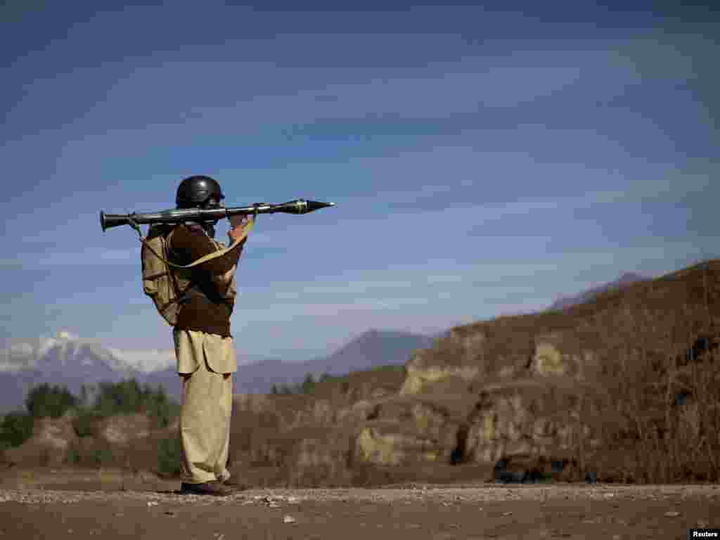 A Pakistani soldier holds a rocket launcher while securing a road in Khar near the border with Afghanistan. - Photo by Adrees Latif for Reuters
