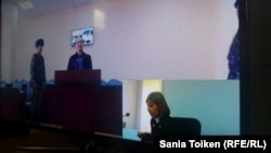 Toktar Toleshov testified through a video link from Astana on October 17.