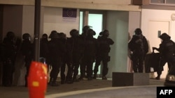 Police conduct a raid in the Croix-Rouge suburb of Reims on January 8 in pursuit of leads and suspects following the deadly attack on the Charlie Hebdo offices in Paris the previous day.