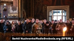 People attend a mass in Kyiv at the weekend to commemorate Ukrainian fighters who died in the battle for Donetsk Airport, which ended when the facility was overrun by separatist forces on January 21, 2015.