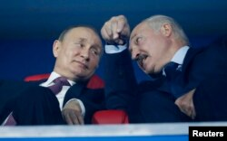 Putin with Lukashenka at the closing ceremony of the European Games in Minsk in June.