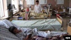 Men who were injured in a bus accident receive medical treatment at a hospital in Kandahar on April 26.