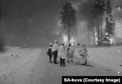 Buildings burn in a suburb of Helsinki.