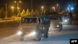 Turkish soldiers drive toward the border with Syria near Akcakale in Sanliurfa Province on October 8.