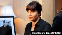Zurab Zhvania's wife Nino Kadagidze beside a picture of her late husband. (file photo)