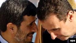 Iranian President Mahmud Ahmadinejad (left) with his Syrian counterpart Bashar al-Assad