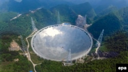China -- A general view of the five-hundred-meter Aperture Spherical radio Telescope (FAST) under construction in the remote Pingtang county, May 7, 2016