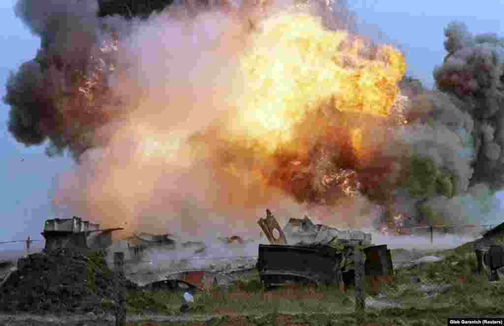 Flames erupt from a blast that demolishes a decommissioned SS-24 nuclear missile at a military base in the southern Ukrainian town of Pervomaysk on September 29, 1998.