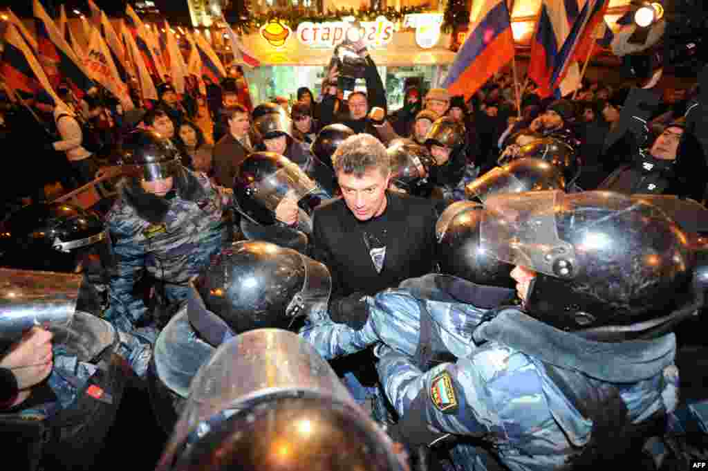 Police encricle Nemtsov as he speaks at an anti-Putin rally in Moscow in 2011 -- the second mass protest in the Russian capital in as many days -- demanding fresh elections after alleged electoral fraud.