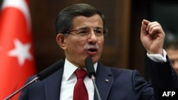 Turkey -- Turkish Prime Minister and leader of the Justice and Development Party (AKP) Ahmet Davutoglu delivers a speech during an AKP meeting at the Grand National Assembly of Turkey (TBMM) in Ankara, December 8,2015