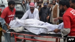 The body of one of the victims outside a hospital in Quetta