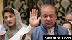 FILE: Ousted Pakistani prime minister Nawaz Sharif gestures as he leaves after a press conference of his daughter Maryam Nawaz (L)