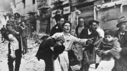 file -- Picture dated 28 February 1947 shows the scene after a terror attack in Ben Yehuda Street in Jerusalem. On November 29, 1947, the United Nations' General Assembly voted resolution 181 on the partition of Palestine in two states, one Jewish and one