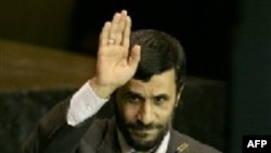 Mahmud Ahmadinejad waves after delivering his speech to the UN General Assembly in 2005.