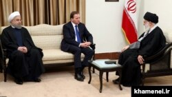 Supreme Leader Ali Khameni (right) and President Hassan Rohani (left) meet with Swedish Prime Minister Stefan Lofven in Tehran on February 11.