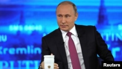 Russian President Vladimir Putin speaks during the call-in show on June 15.