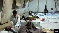 Injured civilians are being treated in a makeshift hospital in Lashkar Gah, Helmand on March 10.