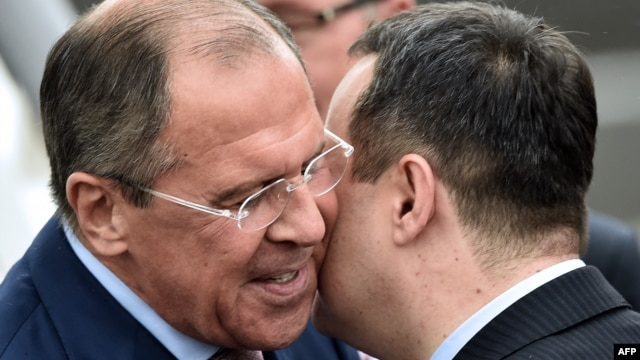 Serbian Foreign Minister Ivica Dacic (right) welcomes his Russian counterpart Sergei Lavrov at Belgrade's airport on June 16.