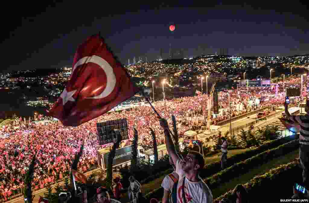 People gather on Martyrs Bridge in Istanbul to attend the second anniversary of the defeat of an attempted coup. (AFP/Bulent Kilic)