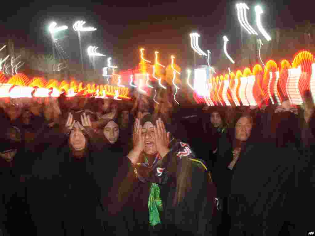 Thousands of Shi'ite women perform the Arba'in mourning ritual outside the Imam Abbas Shrine in Karbala, Iraq.