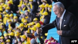 Kazakh President Nursultan Nazarbaev gestures during a ceremony to mark the Day of the First President in Astana on December 1.
