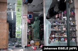 A looted souvenir shop after a night of protest on June 2 in Manhattan is the image Russian TV wants to show.