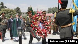 Afghan President Hamid Karzai prepares to lay a wreath at Independence Day celebrations in Kabul on August 18.