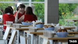 Children eat at the Orlyonok children's camp, where more than 100 children required hospitalization, in Krasnodar in June.