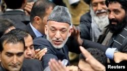 Президент Афганистана Хамид Карзай после собрания Совета старейшин - Лойя-джирги. Кабул, 24 ноября 2013 года.
