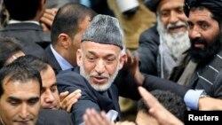 Ауғанстан президенті Хамид Карзай (ортада). Кабул, 24 қараша 2013 жыл.