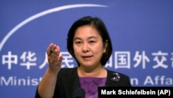 CHINA -- Chinese foreign ministry spokeswoman Hua Chunying gestures during a press briefing at the Ministry of Foreign Affairs building in Beijing, Septtember, 15, 2017