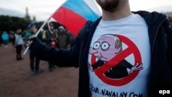 Opposition supporters take part in an unauthorized rally in central St. Petersburg on October 7.